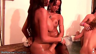 Four t-girls expose huge butts and give each other blowjob