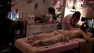 Asian babe in stockings gets fucked in massage parlor