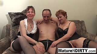 Two grandmas play with a cock and each other