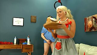 Blond decorates gingerbread house with enema squirts and eats it